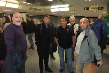 Roger, Jason, Rob, Jon and Ron waiting for the baggage in Belfast