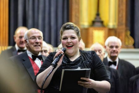 07E. Leigh Mason the Choirs Musical Director tried to steal David Jones job as compere to the amusement of the choir 23/03/19 Credit David Hewitt