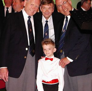 24.Louis Smith with Cyril Jones, Allan Smith (Granddad) and Dave Jones on stage at the Stiwt. Louis who is 8 years old and sings with the Marchwiel Junior School Choir made his big time stage debut with the choir singing When The Saints Go Marching In