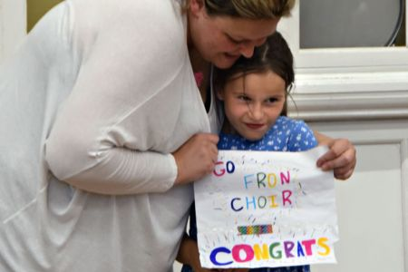48.Emily, one of our youngest fans, with her Congratulations Poster at the first practice after our Eisteddfod win - 12th July